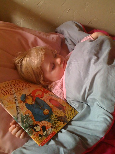 Rory asleep with her book.