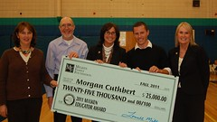 Morgan Cuthbert poses with his $25,000 Milken Educator Award check along with former Maine recipients of the award.