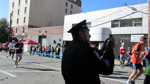 ingnycm2011. before it got super crazy, this officer decided to get his own photo memories.