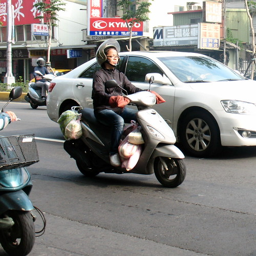 Moped laden with parcels