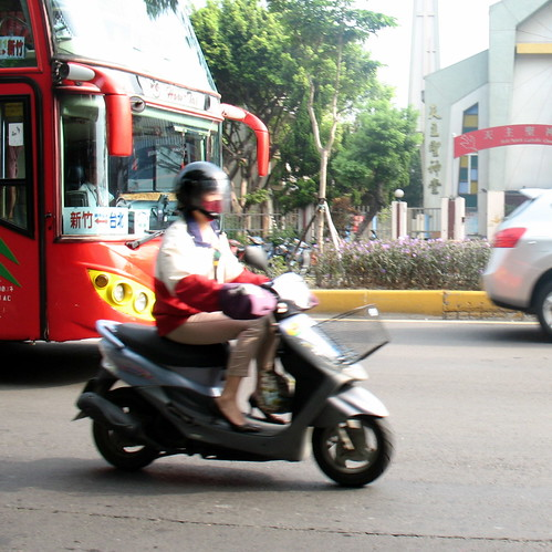Moped driver in high heels