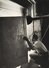 Howard Carter Looking through the Open Doors of Tutankhamun's Second Shrine of Tutankhamun, 1924, by Harry Burton