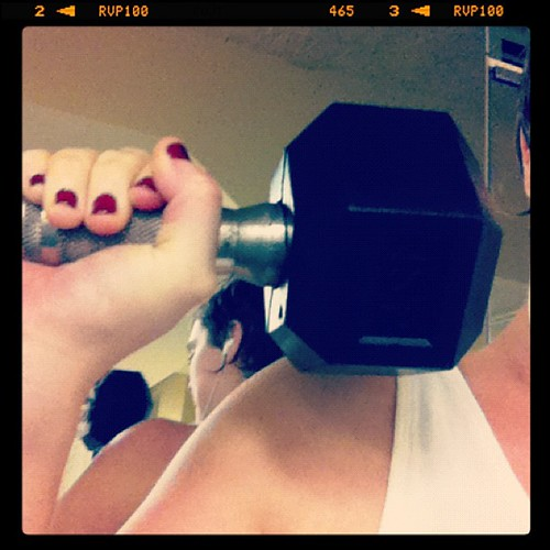 Killerfemme active lifestyle: pumping iron with red nails