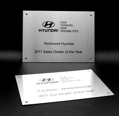 steel-plaques-a4-3off-brushed-finish-black-logo-text by Signmakersuk