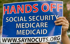 "Sign at Occupy St Pete: ""Hands Off Social Security, Medicaid Medicare""  ""www.SayNoCuts.org"""