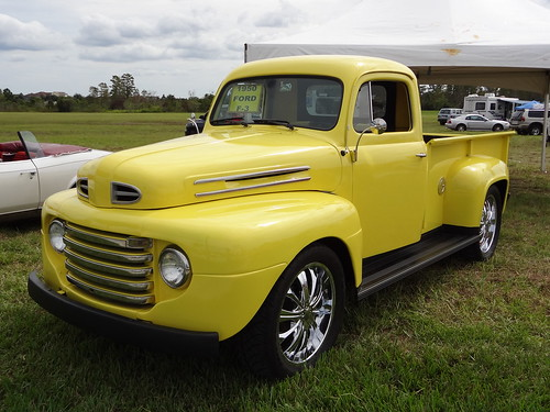 Yellow Truck at Harmony Festival by JimDegerstrom