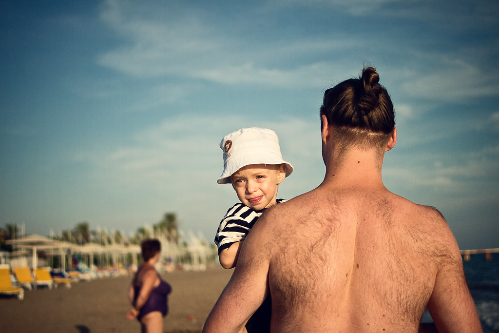 hairy gorilla kidnapping blond boy on the beach