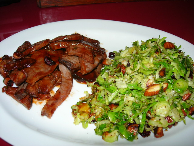 BBQ & Warm Brussels Sprout Salad with Toasted Almonds & Dried Cranberries