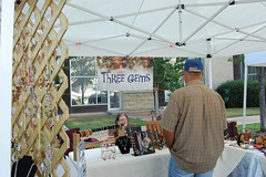 Our craft vendor tent with a customer