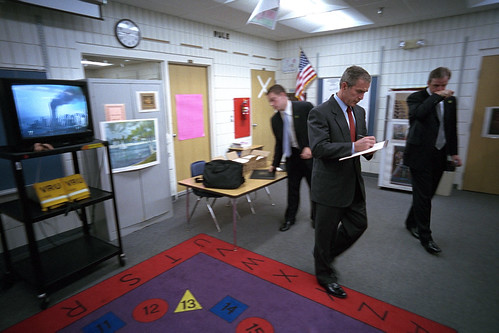 George W Bush turns away from a television set on 9/11