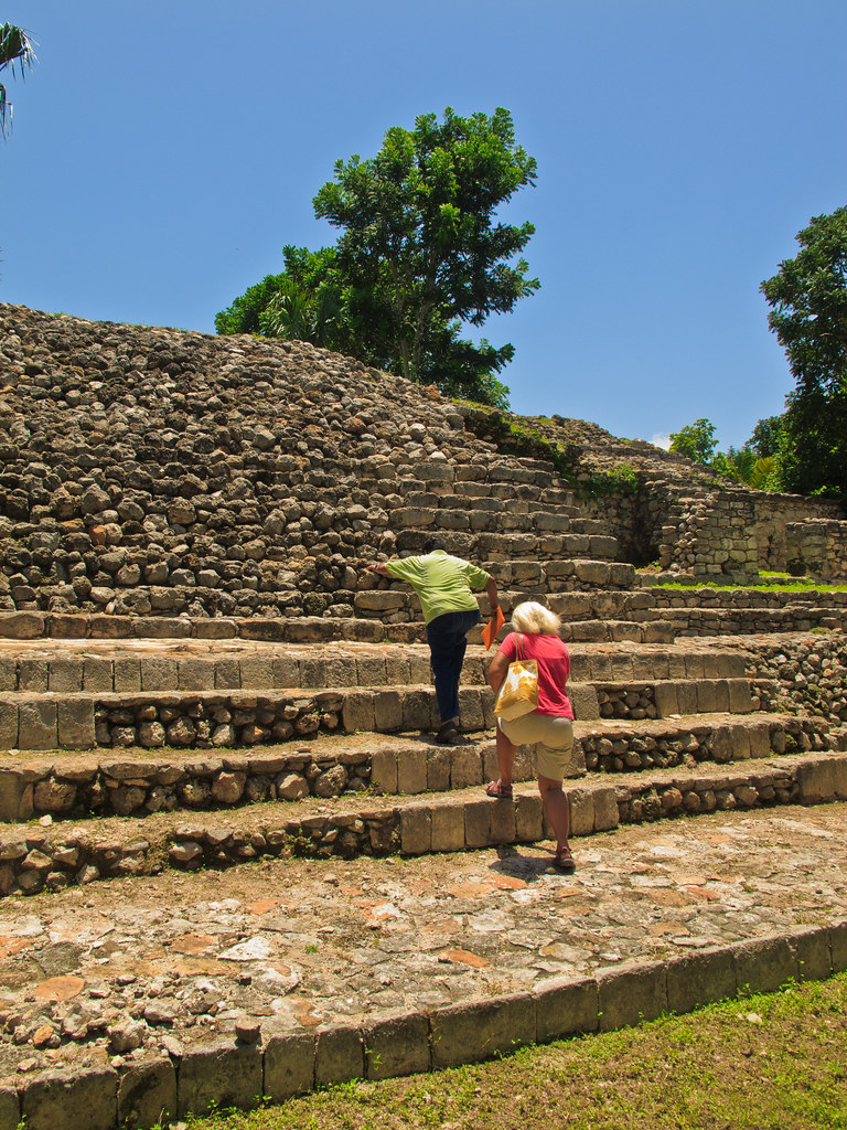"""The custodian leads us up the """"Palace of the Stuccos"""" in Acanceh"""