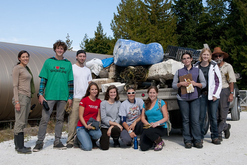 Group with load of debris and garbage