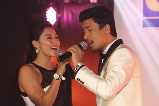Singing couple Carla Dunreanu and Christian Bautista duet while wearing Swatch x Petrantoni watches