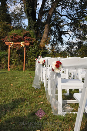Outdoor ceremony aisle decorated by Diamond Events for a wedding ceremony at River Farm
