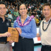 University of Hawaii Alumni Association's Patrick Oki, far left, and Alvin Katahara, far right, presented the award to Hawaiian Airlines' Debbie Nakanelua-Richards.