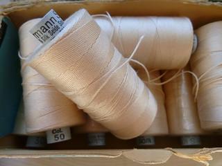 Spools of silk thread (storebukkebruse/Flickr)