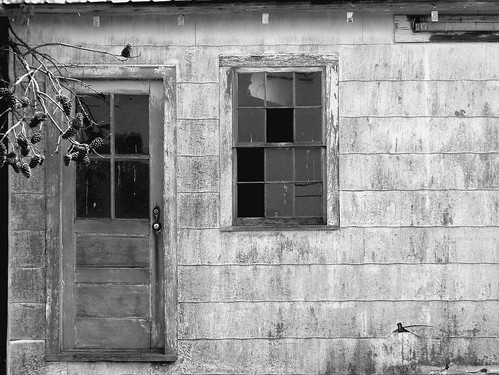 Old barn with broken windows  Abandoned old barn with