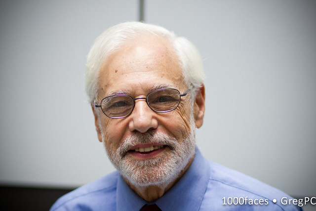 Face - smiling man with white hair, beard and glasses