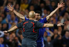 Chelsea's Michael Ballack (right) screams at referee Tom Henning Ovrebo during a Champions League soccer match versus Barcelona at Stamford Bridge in London, by Eddie Keogh