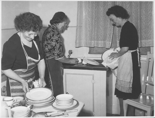 Three unidentified women washing and wiping the dishes, Drouin, Victoria
