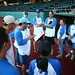 Keith Kashiwada (holding clipboard) assigned positions and batting order for the Kapiolani team in the the UH AUW Softball Tourment at Les Murakami Stadium on Sept. 30, 2011