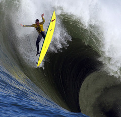 Ion Banner loses control on a giant wave during the first heat of the Mavericks surfing contest, 2010, in Half Moon Bay, CA, by Ben Margot