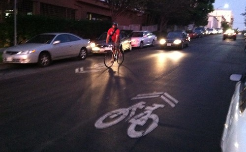 Bicycling at dusk - 4th St. sharrows