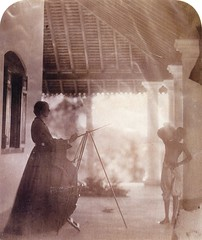 Depicts Marianne North painting a Tamil boy, Ceylon, 1877, by Julia Margaret Cameron