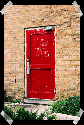 red door - photo treated to look as if taped onto black paper