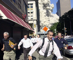 People flee from debris caused by collapse of World Trade Center, by Suzanne Plunkett