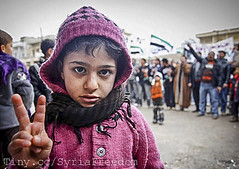 A young girl gestures during an anti-Assad pro...