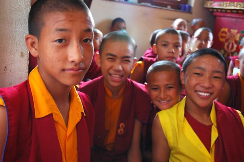 Young Tibetan Buddhist monks smiling and happy...