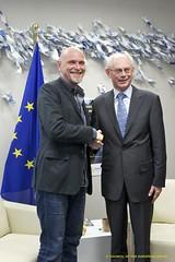 President Van Rompuy shakes hands with a membe...