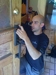 "Locksmith installing a gripset in Toronto • <a style=""font-size:0.8em;"" href=""http://www.flickr.com/photos/61091887@N02/6821378274/"" target=""_blank"">View on Flickr</a>"
