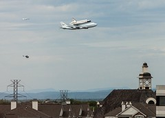Discovery, chase plane, helicopter over the Clocktower Shopping Center