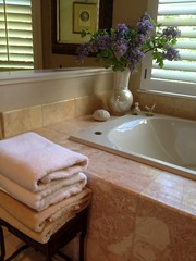 "A stack of fresh towels near the tub • <a style=""font-size:0.8em;"" href=""http://www.flickr.com/photos/79686536@N02/7310274760/"" target=""_blank"">View on Flickr</a>"
