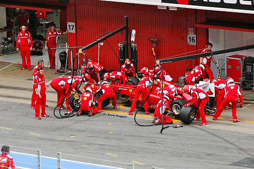 The Ferrari team practice a pit stop for Fernando Alonso at Formula One Winter Testing, Circuit de Catalunya, March 2012