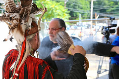 Barnaby Evans being smudged by Roger Desrosiers of the Poconocutt Nation