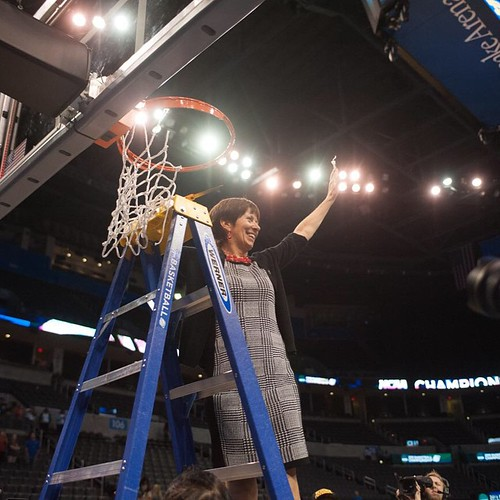 Irish head coach Muffet McGraw cuts down the nets after @ndwbb reached its fifth straight Final Four with a win over Baylor (photo credit: Jodi Lo   The Observer)