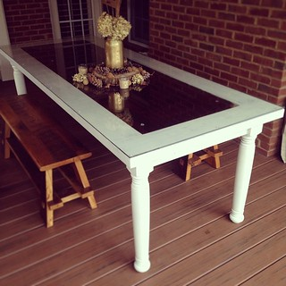 Recessed a 100 yr old pantry door from this clients grandparents home into our table top to create this patio table.   #langecustoms  #recylingfamilymemories