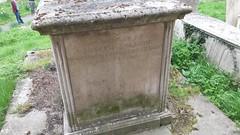 Salmon box tomb at foot of church tower