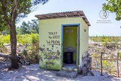 "A local toilet at a restaurant or ""warung""."