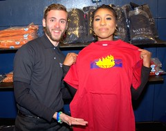 Intern and Volunteer Showing off Merch