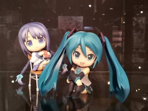 Tooko is sitting with Miku