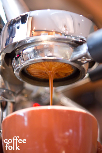 Bottomless photo of espresso extraction.