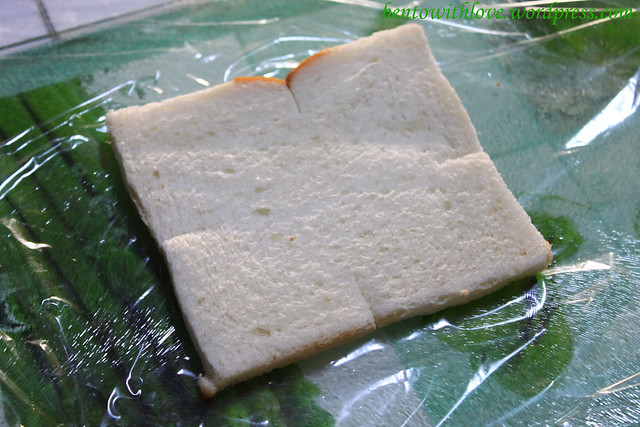 Place pread on a sheet of clipwrap and snip a 1cm line on the 4 sides of the bread