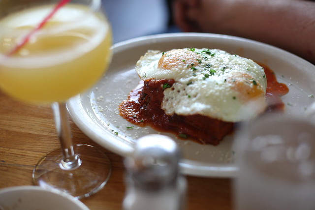 baked eggplant parmesan topped with a fried egg