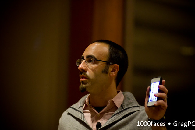 Face - man with glasses holding iPhone