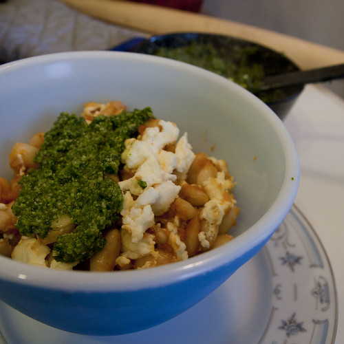 Chipotle-Tomato Sauced Canellinni Beans with Feta and Cilantro-Pepita Pesto