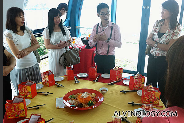 A butler in the capsule going through the itinerary for the Singapore Flyer Lou Hei